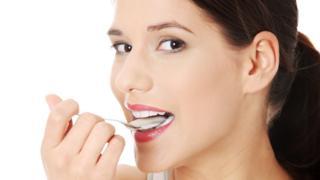 Generic picture of woman eating yogurt