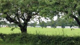 Travellers' vans on a school field