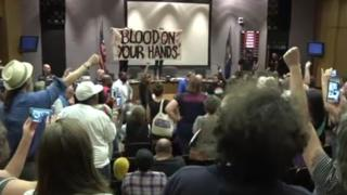 Protesters at a city council meeting in Charlottesville, Virginia.