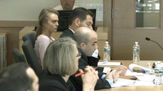 Carter on Friday waiting to hear if the judge would dismiss her case