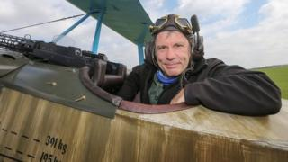 Bruce Dickinson in a World War 1 biplane