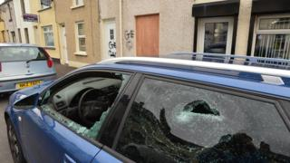 Car with smashed windows outside house in Larne, 4 August 2016