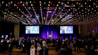 Prime Minister Malcolm Turnbull's image is displayed on a screen at an official Liberal Party function in Sydney