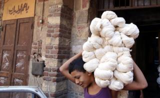 "Moustafa, 15, carries white yarn rolls at Salama""s tannery in Cairo, Egypt, 07 November 2017. Salama started working when he was seven years old during the reign of King Farouk over Egypt because, according to him, the police used to arrest unemployed males of all ages. Now, after almost 70 years, Salama""s tannery is the only one left in the old part of Cairo. The yarn produced is used for shoe laces, mattresses upholstery, ballet dance outfits,"