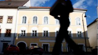 Person passes house in which Adolf Hitler was born