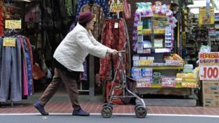 An elderly woman using a walker in Japan