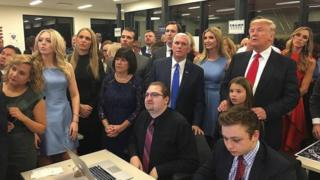 US presidential candidate Donald Trump (standing, right) watches election results with family and supporters.