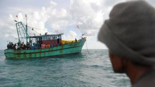 This picture taken on June 11, 2016 shows migrants from Sri Lanka on board a boat off the coast of Banda Aceh. Dozens of Sri Lankan immigrants bound for Australia were stranded off Aceh in northwest Indonesia after their boat broke down, local officials said on June 12. / AFP / CHAIDEER MAHYUDDIN (Photo credit should read CHAIDEER MAHYUDDIN/AFP/Getty Images)