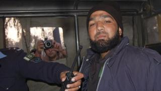 Malik Mumtaz Hussain Qadri, a bodyguard who killed Punjab governor Salman Taseer, is photographed after being detained at the site of Taseer's shooting in Islamabad, in this 4 January 2011 file picture