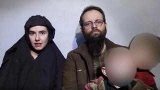A still image from a video posted by Afghan insurgents on social media showing Caitlan Coleman, her Canadian husband Joshua Boyle and two boys