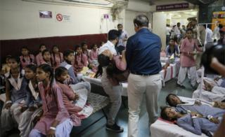 Indian schoolgirls receive medical treatment at a government hospital after gas leak in Tughlakabad, New Delhi on 6 May, 2017.