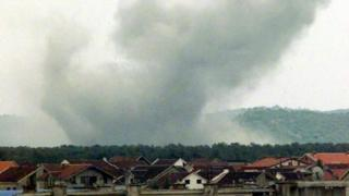 A view of the smoke raising after a Nato airstrike on Golubovci, Podgoricas airport, in Montenegro, Wednesday, April 28, 1999