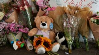 Teddy bears outside Grenfell Tower