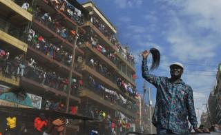 """Kenya""""s opposition leader Raila Odinga arrives in the Mathare district of Nairobi on August 13, 2017. Kenya""""s defeated opposition leader Raila Odinga on August 13 urged his supporters to boycott work, promising to announce on August 15 his strategy after an election he claims was stolen from him"""