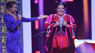 Israel's singer Netta Barzilai aka Netta celebrates with the trophy