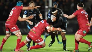 Glasgow Warriors' Brian Alainu'uese is held up by the Scarlets defence