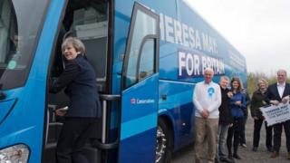Theresa May boards her battle bus