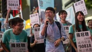 Newly elected legislator Nathan Law Kwun-chung (C) thanks his supporters during a rally in Causeway Bay, Hong Kong, China, 05 September 2016.