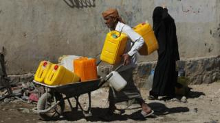 Yemenis wait to collect drinking water from a donated water pipe in Sanaa, Yemen, 18 November 2017