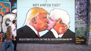 Donald Trump and Boris Johnson embrace depicted in Bristol street art