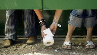 Someone passing toilet roll at Glastonbury