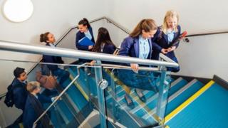 Secondary pupils on stairs