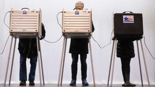 Voters casts their ballots in the primaries in Illinois, Chicago