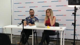 Lyubov Sobol (right) presents the news via her YouTube channel