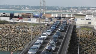 Cars going on to ferry