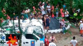 Picture by the National Disaster Risk Management Unit shows ambulances and onlookers near the site of the bridge collapse