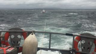 Lifeboat towing broken down dive support boat