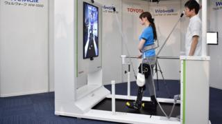 Woman demonstrating the Welwalk WW-1000 robotic brace