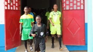 Isaac marches out to referee a game, wearing Howard Webb's shirt