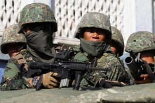 Members of Philippine Marines are pictured aboard a vehicle as more soldiers reinforce to fight the Maute group in Marawi City in southern Philippines 29 May 2017.