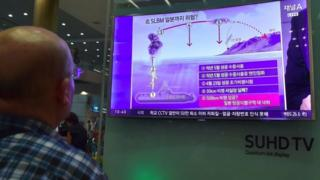 A man watches a news report about the missile launch in Incheon airport, Seoul (24 Aug 2016)