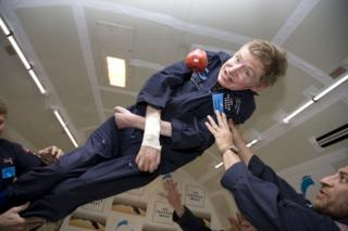 Stephen Hawking floats as he experiences zero gravity