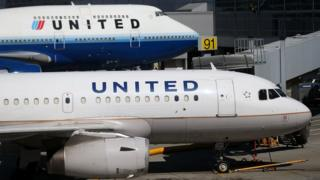 Two United Airlines planes parked at the terminal at San Francisco International Airport on August 24, 2012