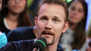 Morgan Spurlock of the appears on stage during MTV's Total Request Live at the MTV Times Square Studios July 7, 2004 in New York City
