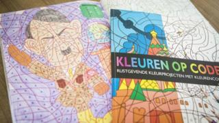 A photo shows a colouring book with an image of Adolf Hitler bought at the Dutch store Kruidvat by Ray Vervloed in Pijnacker, the Netherlands, on April 5, 2017