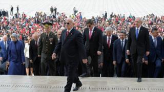 parliamentary speaker Ismail Kahraman walks up the stairs of Ataturk's Mausoleum in Anitkabir, 23 April