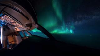 Northern lights and a plane's cockpit