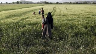 A Syrian refugee with her children in Greece