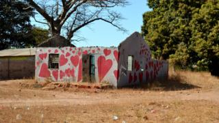 House painted with hearts - painted by community