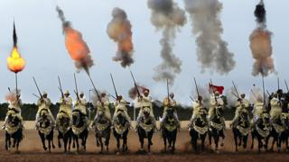 Traditional Moroccan knights fire in an equestrian show during the Festival of Tbourida, a competition between the Moroccan tribes, in Al-Jadidah, Morocco, 18 October 2017. Tbourida is a traditional exhibition of horsemanship in the Maghreb performed during cultural festivals and to close Maghrebi wedding celebrations. The performance consists of a group of horse riders, all wearing traditional clothes, who charge along a straight path at the same speed so as to form a line, the pickup speed and then at the end of the charge, fire into the sky using old muskets or muzzle-loading rifles.