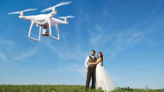 Drone photographing married couple