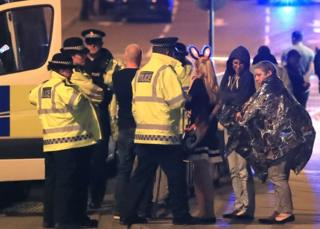 Police and teenagers after Manchester attack