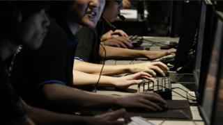 Gamers taking part in esports competition