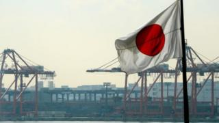 Japanese flag at container terminal