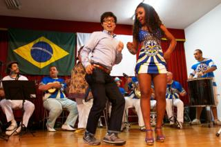 eople dance samba at an event where members of the Japanese community gathered to watch the FIFA 2013 Confederation Cup inauguration match between Brazil and Japan at a community center in the neighbourhood of Liberdade in Sao Paulo, Brazil on June 15, 2013