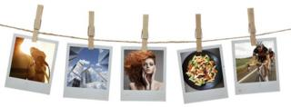 Photographs hanging on pegs